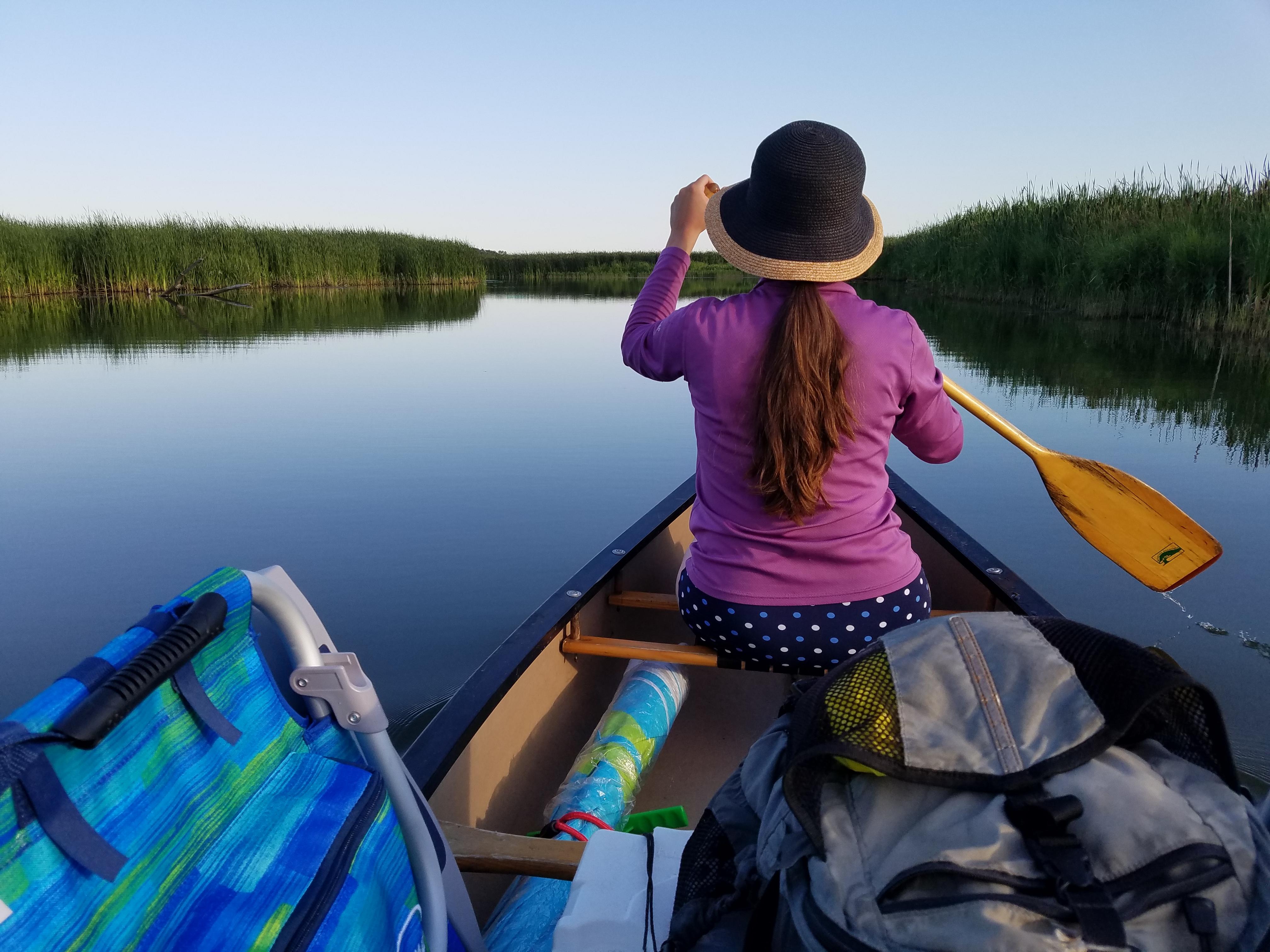 Woman paddling in a canoe