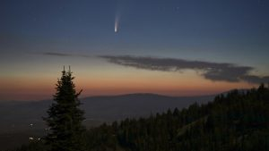 Comet NEOWISE in the sky at sunset
