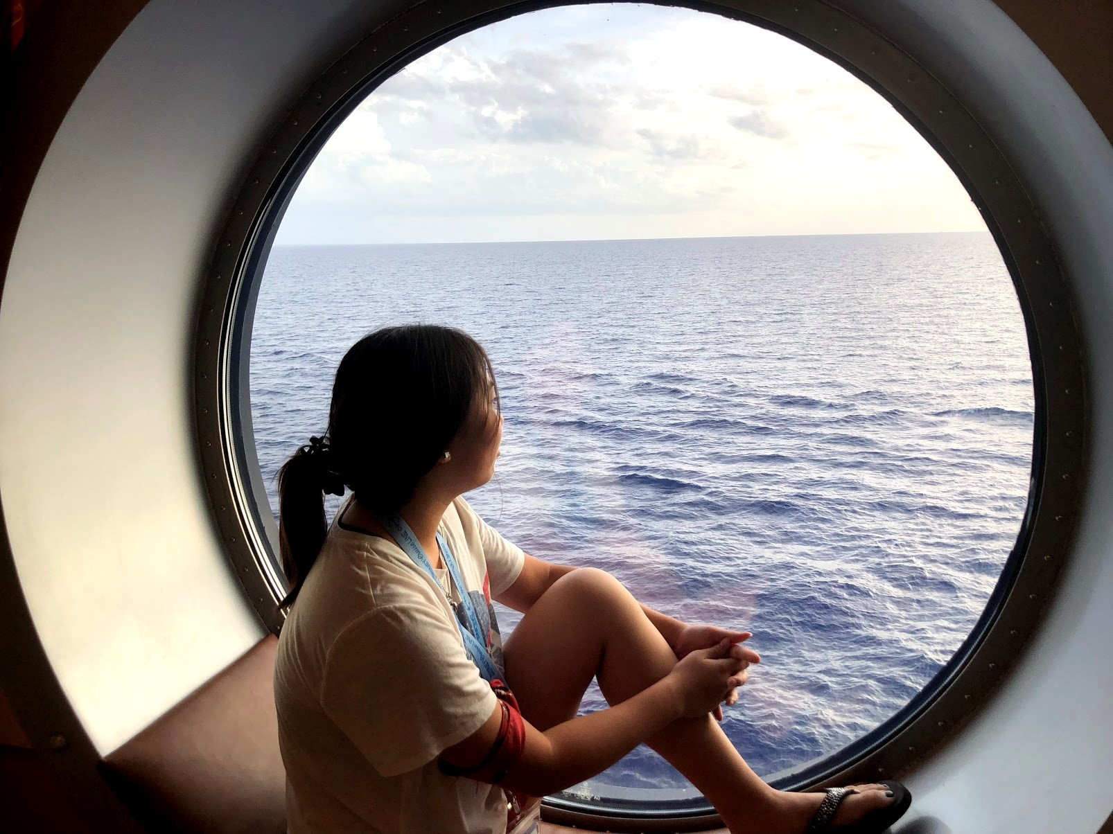 Emily looking out ship window
