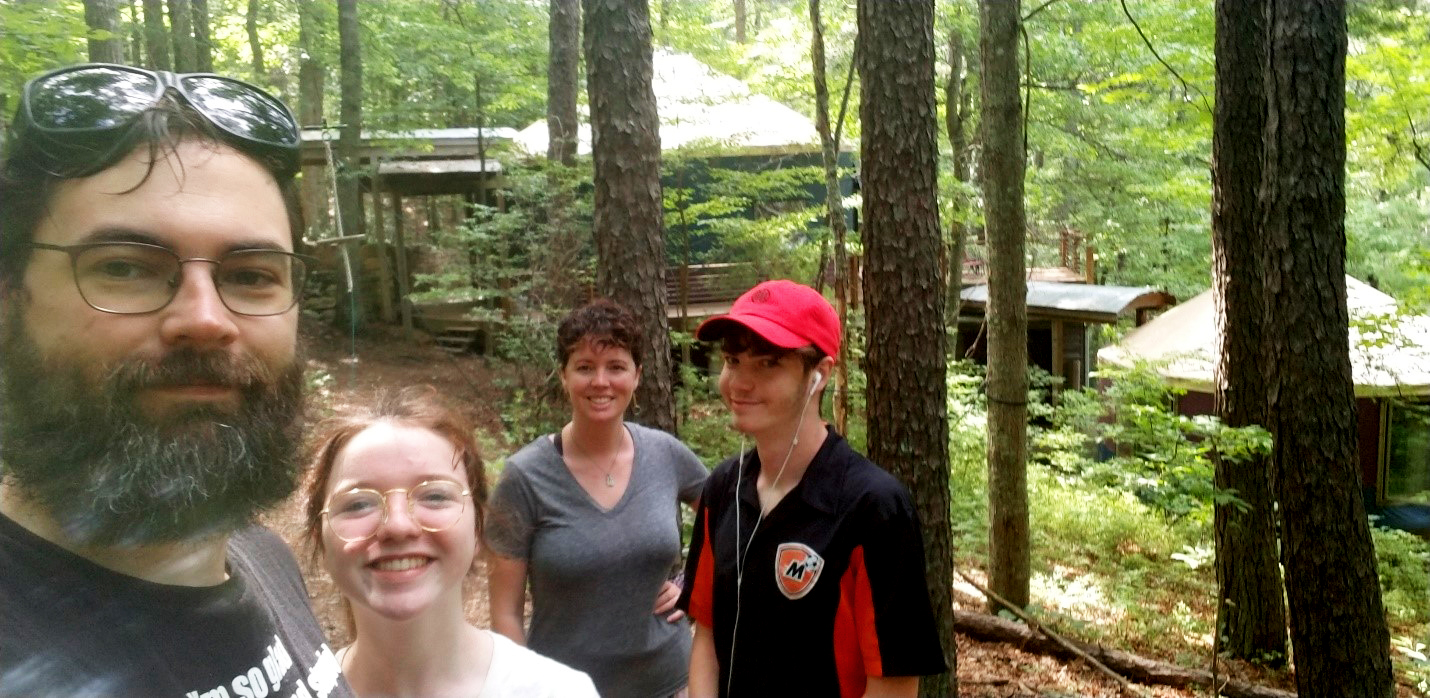 Tom Fazzio and family standing in the woods